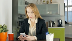 Businesswoman checking smartphone and looks shocked, steadycam shot Stock Footage