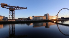 Panning view of Glasgow waterfront with Clyde Arc and SECC, Scotland Stock Footage