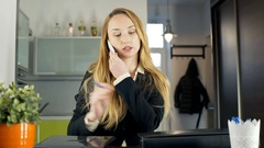 Businesswoman coming to her apartment and talking on cellphone, steadycam shot Stock Footage