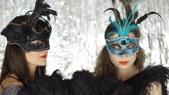 Women in beautiful masks looking serious at the masquerade party, steadycam shot Stock Footage