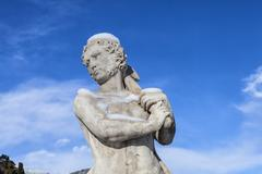 Park of neoclassical Villa Olmo in Como. Mythological statue of male character Stock Photos