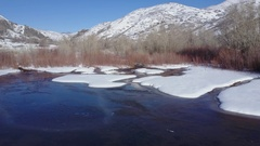 Aerial winter mountain river pond ice snow HD Stock Footage
