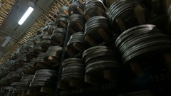 Film Archive. Films, movie reels on a shelfs in a huge old movie archive Stock Footage