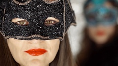 Beautiful woman in black, carnival mask looking to the camera, steadycam shot Stock Footage
