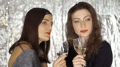 Women chatting about someone at the party, steadycam shot Stock Footage
