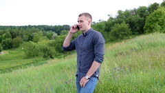 Young man talking on the phone outdoor Stock Footage