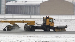 Snow removal vehicle sweeper airport runway Stock Footage