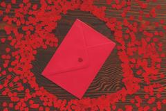 Red envelope with confetti Stock Photos