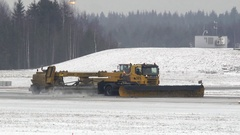 Snow removal vehicle airport runway Stock Footage