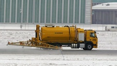 Snow removal anti ice vehicle on airport runway Stock Footage