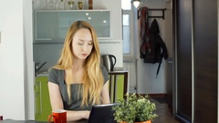Businesswoman taking coffee and working on laptop, steadycam shot Stock Footage