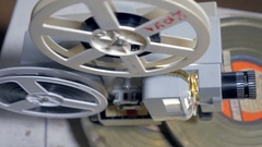 Vintage, old film projector with turning reels Stock Footage