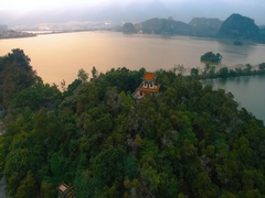 Aerial panorama of  city with  lake and the temple on  top of cliff Stock Footage