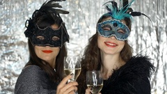 Beautiful women holding glasses with champagne and smiling to the camera, steady Stock Footage