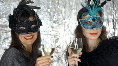 Attractive women turning to the camera with champagne and smiling, steadycam  Stock Footage