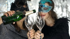 Woman pouring champagne and having a toast with her friend, steadycam shot Stock Footage