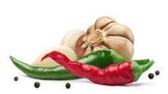 Garlic, cayenne, peppercorns, paths Stock Photos