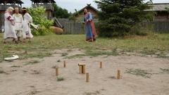 Actors plays gorodki in Kyivan Rus park, Kopachiv village, Ukraine Stock Footage