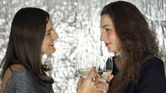 Happy women holding champagne and chatting with each other, steadycam shot Stock Footage