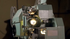 Old-fashioned antique film projector working Stock Footage