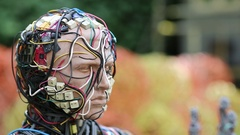 Face of sculpture of human, made of electric wires and electronic devices Stock Footage