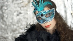 Woman in carnival mask fluttering with fan and looking to the camera, steadycam  Stock Footage