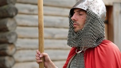 Knight in armours with spears guards the old wooden fortress Stock Footage