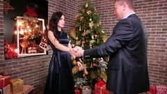 New Year's party near the Christmas tree, family is beautiful dances in the Arkistovideo