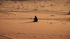 Photographer in Wadi Rum desert, Hashemite Kingdom of Jordan Stock Footage