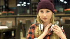Hipster girl improves her appearance and smiles to the camera, steadycam shot Stock Footage