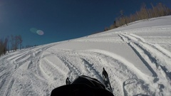 Snowmobile climbing steep mountain winter 4K POV Stock Footage
