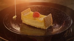 Piece of cheesecake pour a thin stream of sweet cream sauce Stock Footage