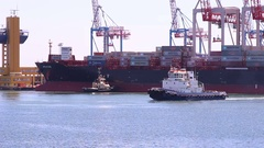 Close up of two tugboats sailing in Odessa port harbor. Stock Footage