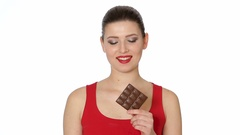Woman with red lipstick eats dark chocolate Stock Footage