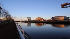 Panning view of Glasgow waterfront including SECC and Finnieston Crane Scotland Stock Footage
