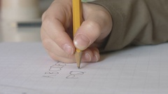 Child writing alphabet letters RST close up Stock Footage