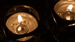 Close up two tealights in holder evening Stock Footage