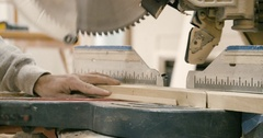 Carpenter Uses Table Saw to Cut Piece of Wood Trim at Home Construction Site Stock Footage