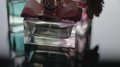 Bottles Of Perfume And Toilet Water Spinning On The Table Stock Footage