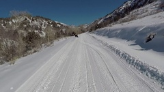 Snowmobile recreation winter mountain trail POV HD Stock Footage
