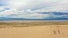 Movement of the clouds over the salted lake Durgun Nuur, Mongolia. Full HD Stock Footage