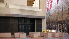 Outside of the entrance to the J. Edgar Hoover FBI building in Washington DC Stock Footage