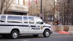 FBI police van outside of the J. Edgar Hoover FBI building in Washington DC Stock Footage