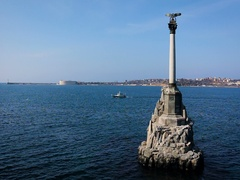 Lonely Ship Sails on the Sea Near the Monument to the Scuttled Ships in Stock Footage