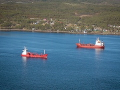 View of One Ship Stands Still, Other Moves. Two Vessels of Similar Size Are on Stock Footage