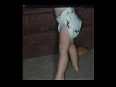 Baby boy in diapers crawling around Stock Footage
