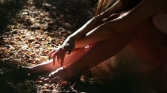 Summertime female portrait of a girl playing with sun light touching fingers Stock Footage