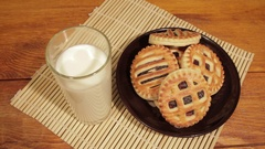 Man breakfast with milk and cookies on the wooden desk Stock Footage