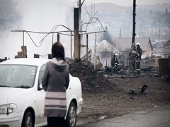 Old Woman Walking Along the Road to the Firefighters. View of the Burned Stock Footage