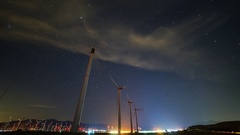 Astro Timelapse Low Angle Shot of Windmills in Palm Springs  Stock Footage